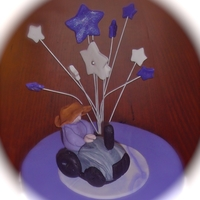 Farmer On His Tractor   The cake topper for a cake made for a grape farmer turning 90 yrs old.
