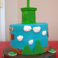 My Son's Super Mario Bday Cake Buttercream frosting with candy clay and white chocolate accents.
