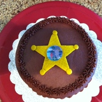 Sheriffs Star  Chocolate Espesso Cake with Whipped Dark Chocolate Ganache filling Chocolate Butercream frosting. The star is my first sad atempt at making...