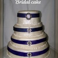 Purple & White W/ Bling my FIRST wedding cake!! YAAAAY!! It was a monster to finish and didn't think I would EVER be done!! But, I'm happy with the...