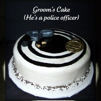 On Target  for a groom that is a police officer. gun & badge made out of fondant, the gun has an edible center....but that's all I'm...