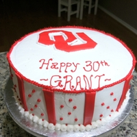 Grant's Ou Cake yellow cake w/buttercream icing, cheese cheese icing as filling, fondant logo and stripes