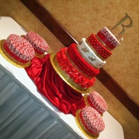 Ruby's 15 Cake   Used buttercream icing throughout and fondant petals on bottom tier.