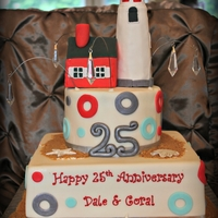 25Th Anniversary Lighthouse Cake The happy couple was engaged at a local lighthouse, so their daughter asked if I could incorporate the lighthouse and beach theme into the...