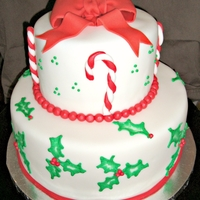 Christmas Holly Two tiered chocolate cake with peppermint buttercream. Decorated with fondant candy canes and brushed embroidery holly