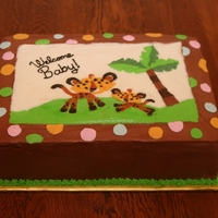 Welcome Baby Fisher-Price Jungle Theme I donated a cake to a school auction, and they requested a cake to match their Fisher-Price Jungle Animals babyshower theme. I chose the...