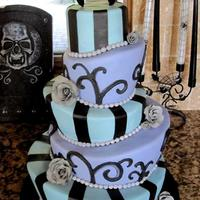 Halloween Wedding Cake Topsy Turvy Mad Hatter Tiers Bride Of Frankenstein Topper With Roses And Pearls Blue Purple Black And Gray T Halloween wedding cake, topsy turvy / mad hatter tiers, bride of frankenstein topper with roses and pearls. Blue, purple, black, and gray....