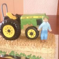 My Brothers Birthday Cake The Tractor Is Carved From Sour Cream Pound Cake The Big Tires Are Donuts And The Small Ones Are Cake The Bott My brother's birthday cake. The tractor is carved from sour cream pound cake. The big tires are donuts and the small ones are cake....
