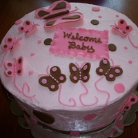 Butterfly Baby Shower Cake 10 inch strawberry yogurt cake with strawberry buttercream frosting. All decorations from fondant.