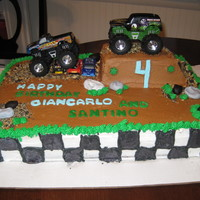 Monster Truck Cake This is a 2 layer half sheet cake. Ramp was made out of pound cake. Rocks were fondant. Dirt was made from crushed oreo and vanilla cookies...