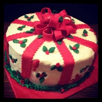 Christmas Present Cake Ten inch round red velvetFondant BowThanks for lookingTeresa's Sweet Boutique