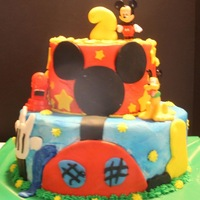 Mickey Mouse Clubhouse Kids love the mickey clubhouse cakes.Thanks for lookingTeresa's Sweet Boutique