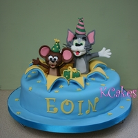 Tom & Jerry   Surprise its Tom and Jerry! Vanilla sponge with vanilla butter cream. Figures made with fondant.