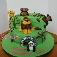 Ellen's Zoo Zoo animal themed cake. Animals (except for Panda) made of marzipan. First time I've used this as a model medium and I'm not sure...