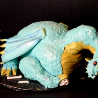 Dragon Cake Over 2000 circle were cut and placed on this cake for scales! Phew!
