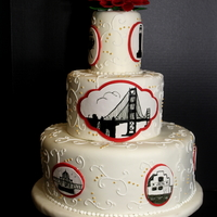 San Francisco Themed Wedding Cake  San Francisco themed wedding cake. 10 individually, hand-painted San Francisco landmarks on cake. Gumpaste red dahlia as topper. Sizes 12,...