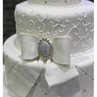 4 Tier Fondant Covered Wedding Cake Gumpaste Bow   4-tier fondant covered wedding cake. Gumpaste bow.