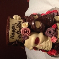 Skull And Roses Cake Chocolate biscuit cakeRed velvet with white ganacheChocolate with dark ganacheLemon drizzle with white ganacheCovered in chocolate with...