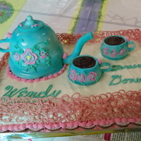 Tea Pot Cake This is a teapot cake ordered for the May Birthday Party at a local business. The teapot and cups are devils food cake with buttercream...