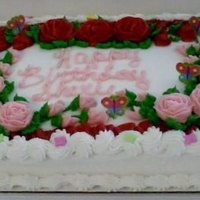 Red And Pink Roses In Buttercream Icing red and pink roses in buttercream icing