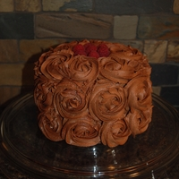 Yes, Another 1M Rose Cake:)   Chocolate cake with mocha ganache buttercream with raspberry filling.