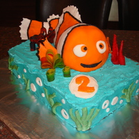 Finding Nemo Cake Rice krispy nemo covered in wilton Fondant. Buttercream icing with fruit roll-up coral.