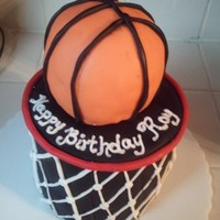 Basketball Cake Basketball cake. ball is made out of rice krispies treat.