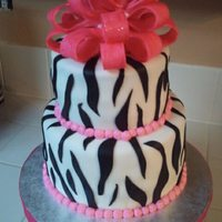"Zebra Striped Birthday Cake Two tier. 6 inch and 8 inch. Covered with white fondant and black""zebra"" stripes. Hot pink fondant bow."