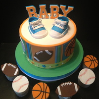Sports Themed Baby Shower Cake All Done In Fondant Sports themed baby shower cake. All done in fondant.