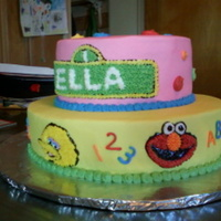 Sesame Street Sesame Street cake for a girl's first birthday. Vanilla cake with buttercream.