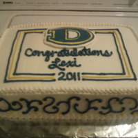 Downingtown West Graduation Chocolate cake filled and iced with buttercream. My first time doing scrolls.