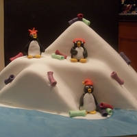 "Penguin Party 12"" Fruit Cake carved to look like snow peaks, with Party Penguins."