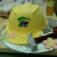 Hard Hat Habitat For Humanity Cake Hard hat is cake covered in fondant and nails, hammer, saw and flowers are all made of gumpaste.