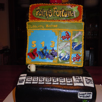 Slot Machine Cake Fairy's Fortune Slot Machine cake. Top is rice krispy covered in fondant with fondant cutouts attached to create the game screen.