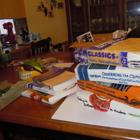 Graduation Books Large stacked books are cake covered in fondant next to the actual school books (smaller stack) that I modeled the cake from..