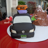Road Trip Cake Car is cake covered in fondant, people are made out of modeling chocolate, mountain is rice krispy covered with buttercream, suitcases are...