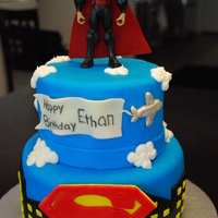 Superman Birthday Birthday cake for a boy's 3rd Birthday Party. The Superman on top is a store bought action figure. Superman symbol made out of...