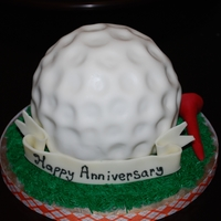 Golf Ball Fondant covered golf ball with modeling chocolate sign and tee.