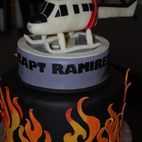 Firefighter's Helicopter Made this cake for a Firefighter Helicopter Pilot. Helicopter made out of RKT and modeling chocolate. It was little tricky because it was...