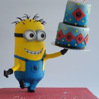 3D Minon Cake This cake I made for my sons birthday.A 3 d minion who holds a real cake, this was a chocolate brownie cake with raspberry creamMy son...