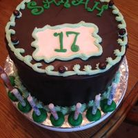 17Th Birthday Cake Three layer chocolate fudge cake covered with buttercream, then chocolate with fondant decorations. In the filling were mini junior mints...