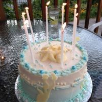 "Birthday Cake Four layer 9"" yellow cake with buttercream and white chocolate accents for a beach themed birthday party. TFL!"