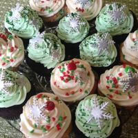 Christmas Cupcakes Chocolate and scratch funfetti cupcakes with buttercream and fondant snowflakes. TFL!