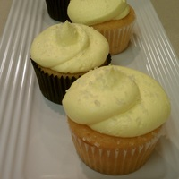 Tropical Breeze These are passion fruit cupcakes filled with guava and topped with pineapple cream.