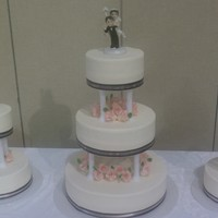 My First Traditional This was my first traditional wedding cake. Very basic white cake with bc but all my time was put into making the 45 roses. This was my...