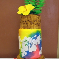 "Tropical Themed Cake With Sugar Hibiscus Flowers!  My daughter helped me deliver this cake. After we set it all up she said, ""It makes me want to go to the beach!"" haha! Yes! The..."