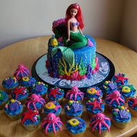 The Little Mermaid Cake And Cupcakes  Made for a little girl's 6th birthday; cupcakes were frosted with buttercream and decorated with fondant sea creatures; cake was 3-...