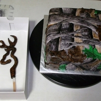 "Realtree Camo And Browning Logo Groom's Cake 10"" square cake covered with fondant and hand-painted to resemble RealTree (c) camouflage pattern. Browning (c) logo made of gumpaste..."