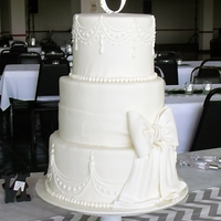 Colleen's All-White Wedding Cake All-white wedding cake decorated with fondant; top tier was double chocolate, middle strawberry cream cheese, bottom golden butter with...