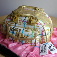 3D Coach Tattersall Purse Cake Butter pecan cake frosted, covered/decorated with fondant; detail on purse hand-painted.